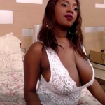 Busty Naomi loves showing off sexy on cam